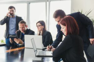 Business people around desk