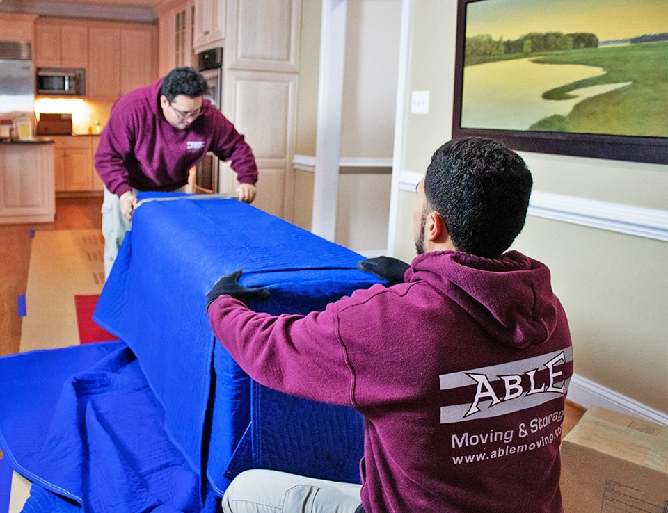 Able Moving & Storage team members moving furniture