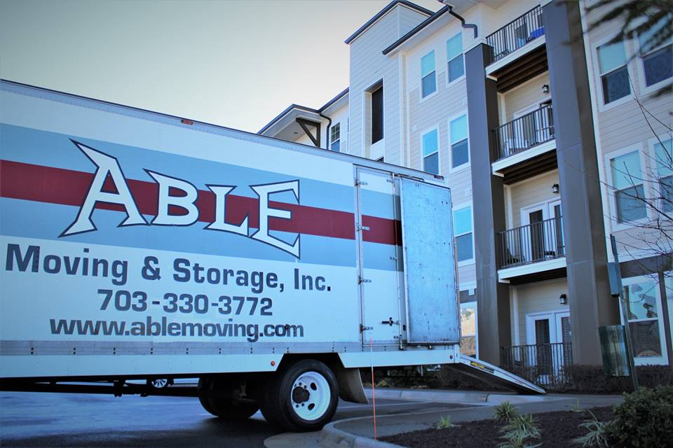Able Moving & Storage truck outside apartment