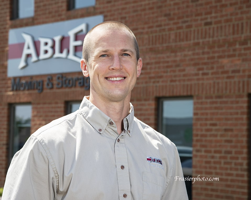 Able Employee in front of Office