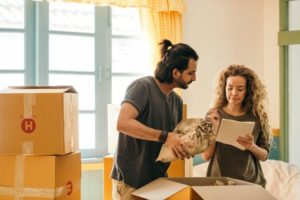 A Chantilly VA couple packing up boxes for a residential moving service